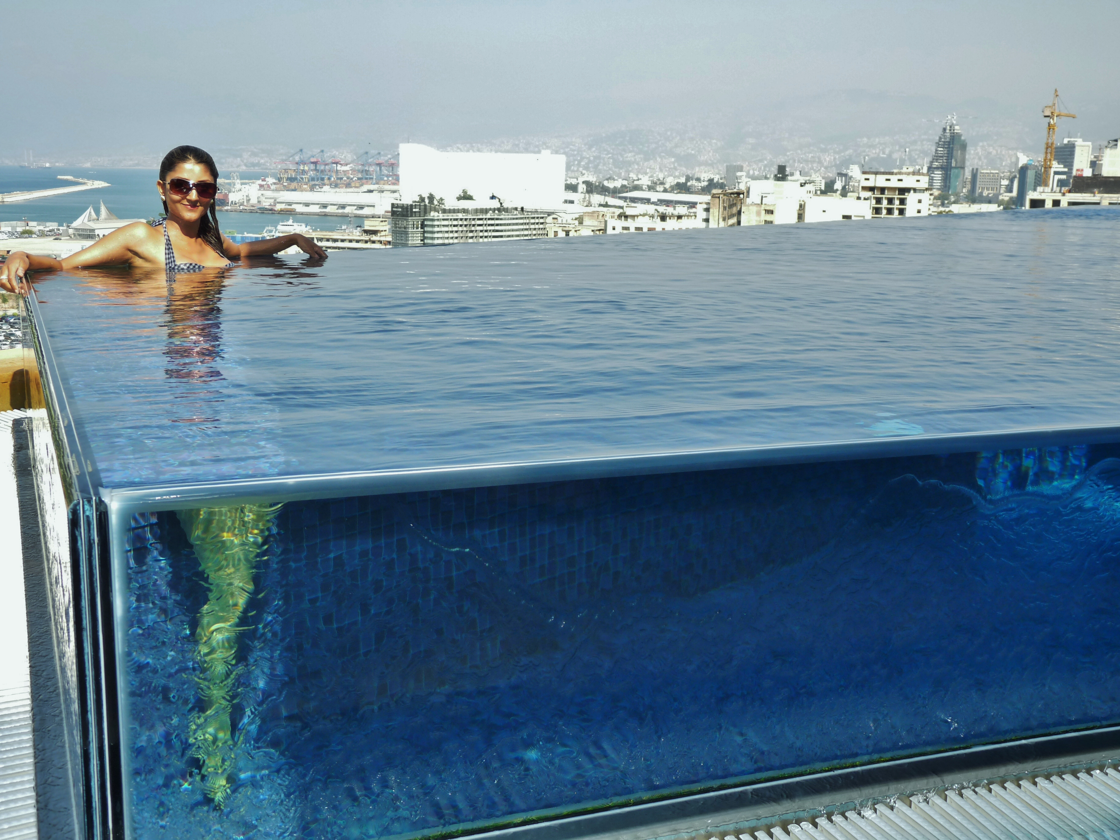 Law of refraction demonstrated perfectly by glass box for Rooftop pool design