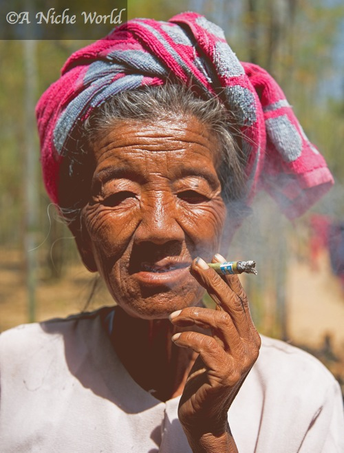 """Indein village"" ""elderly Myanmar lady"" ""elderly Burmese woman"" ""elderly woman smokes cigar"" elderly woman creases"" ""Myanmar tribeswoman"" ""old woman smoking cigar"" ""tribe Myanmar"" ""tribe Burma"" ""long-neck woman Burma"" ""Padaung"" ""Padaung tribe"" ""Kayah State"" ""Kayan Lahwi"" ""kayan Lahwi tribe"" ""tribes Myanmar"" ""tribe Burma"" ""Pao tribe Myanmar"" ""Pao tribe Burma"" ""tribal people Burma"" ""tribespeople Burma"" ""photos tribe Asia"" ""tribal culture"" ""Buddhist"" ""meditation"" ""Buddhist kingdom"" ""Buddhism origin"" ""mandalay"" ""sights mandalay"" ""things to see Burma"" ""sights Burma"" ""things to see Mandalay"" ""holiday Burma"" ""travel Myanmar"" ""myanmar or burma"" ""religion Burma"" ""Buddhism"" ""Asia"" South-East Asia"" ""travel"" ""solo female travel Asia"" ""portrait"" ""people Asia"" ""people Burma"" People Myanmar"" ""emerging destination"" ""2013 unusual holiday"" ""travel"" ""trip"" ""voyage"" ""discovery"" ""wanderlust Burma"" ""wanderlust Myanmar"" ""Myanmar itinerary"" ""burma itinerary"" ""what to see in Burma"" ""what to see in Myanmar"" ""sights Inle"" ""Inle Myanmar"" ""Inle Lake sights"" ""Inle Lake Myanmar"" ""Inle pictures"""