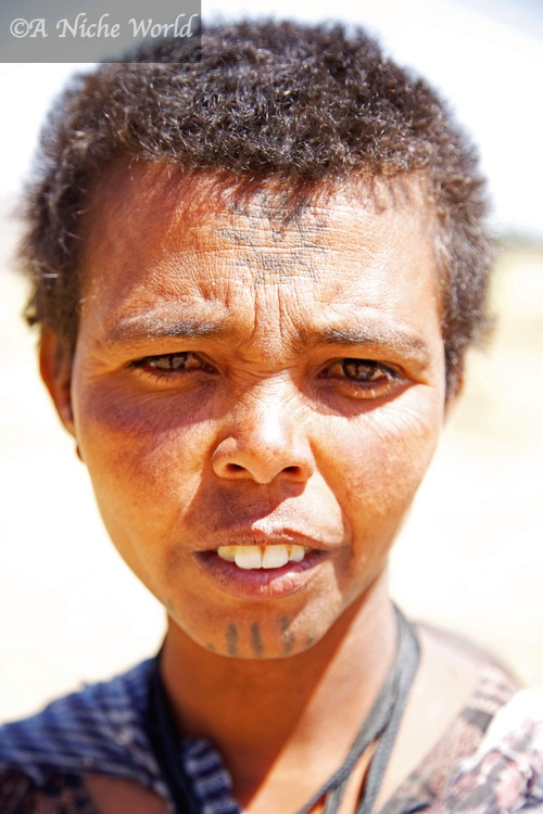Ethiopian woman's neighbourhood / clan origins are clearly identified by her tattoos & markings
