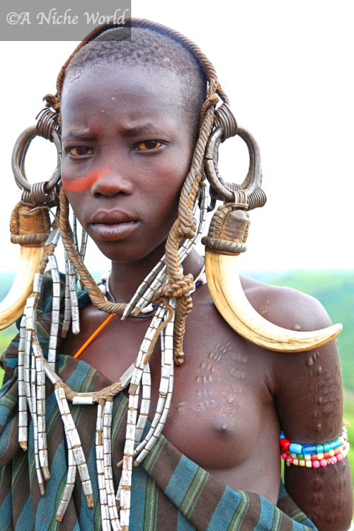 """Mursi tribe"" ""split lip"" ""Mursi village"" ""Mursi Omo Valley"" ""Omo Valley"" ""tribe"" ""African tribe"" ""Ethiopia tribe"" ""Omo Valley tribes"" ""Hamer tribe"" ""Dorze"" ""Mursi"" ""Konso"" ""village"" ""African village"" ""Ethiopia village"" ""Omo Valley village"" ""Lower Omo Valley"" ""Jinka"" ""Ethiopia"" ""South Ethiopia"" ""sights South Ethiopia"" ""South Ethiopia travel"" ""sights Ethiopia"" ""travel Ethiopia"" ""Ethiopia holidays"" ""solo female travel Ethiopia"" ""solo female travel Africa"" ""solo female travel"" ""girls travel"" ""East Africa"" ""African adventure"" ""emerging Africa"" ""emerging destination"" :unusual destination"" ""world's best destination"" ""world's best holiday"" ""UNESCO"" ""UNESCO World Heritage Sites""  ""rastafarian"" ""Jah"" ""origin of rasta"" ""tradition"" ""culture"" ""belief"" ""religion"" ""tribes"" ""tribal"" ""witchcraft"" ""unusual"" ""explore"" ""wanderlust"" ""travel"" ""holiday"" ""Turmi"" ""Konso village"" ""Mursi"" ""Karo"" ""Woleyta"" ""villages Ethiopia"" ""tribes Ethiopia"" ""Sudan"" ""kenya"" ""border Kenya"" ""Sudan border"" ""remote village"" ""isolated tribe"" ""isolated community"" ""nomadic tribe"" ""Semitic"" ""Cushitic"" ""Amharic"" ""tribal tattoo"" ""Anisha Shah travel"" ""Anisha Shah journalist"" ""Anisha Shah BBC"" ""travel photography"" ""photography"" ""portraits"" ""portrait photography"" ""professional photographer"" ""professional travel photography"""