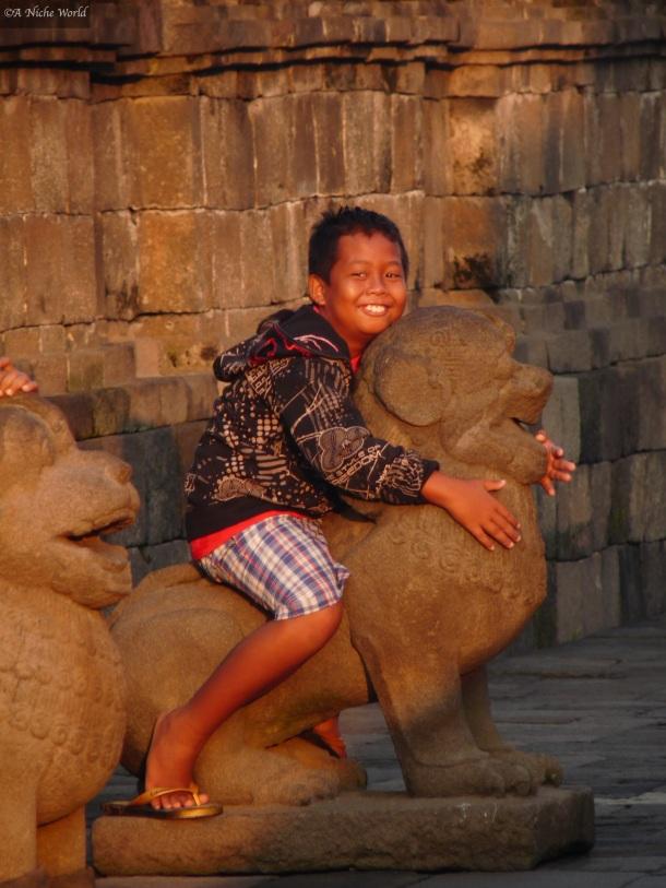"""Borobudur"" ""Indonesia"" ""Java"" ""Buddhism"" ""spiritual"" ""temple""  ""emerging destination"" ""Asia"" ""child"" ""smile"" ""beautiful smile"" ""beauty"" ""portrait"" ""travel"" ""travel photography"" ""portrait photography"" ""photography"" ""beauty"" ""nature"" People"" ""culture"""