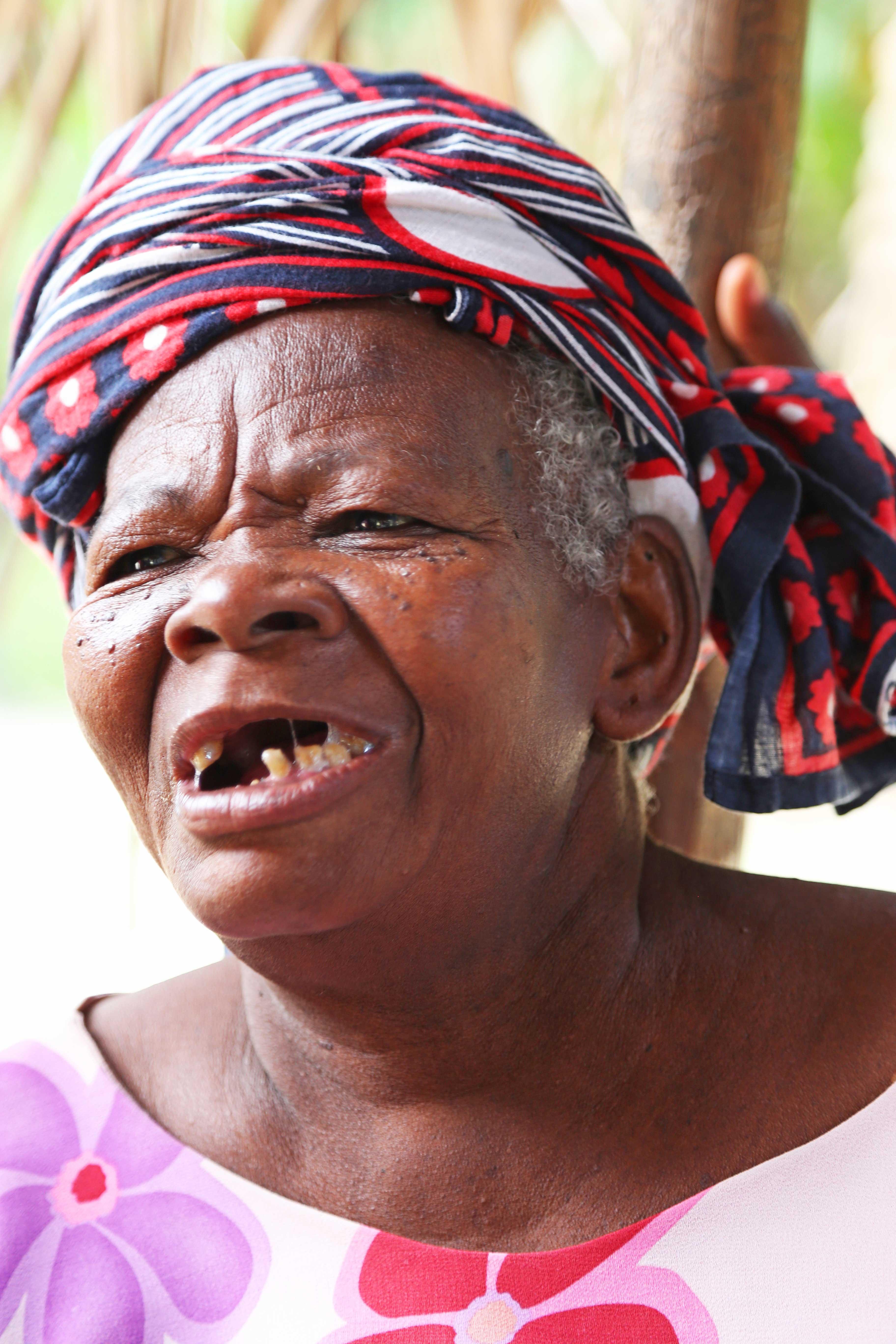 Toothless Zanzibari Lady In Colourful Dress Zanzibar